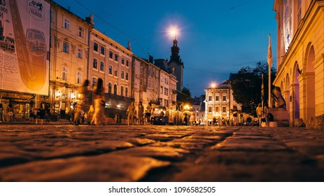Lviv, Ukraine - July 2, 2016 - the center of the old city with many people who admire the magnificent architecture of the ancient city and the cute tram that rides through the square