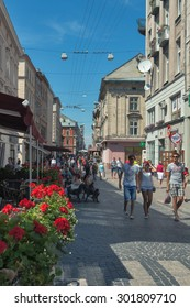 LVIV, UKRAINE - JULY 29, 2014: People walk along pedestrian Galician street with cafe and small shops. The first mention of the street dates back to 1382 and till now its name remains unchanged.