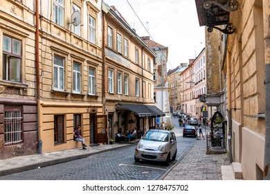 Lviv, Ukraine - July 30, 2018: Streetscape street of historic Ukrainian Polish Lvov city during day with yellow old vintage buildings in local residential neighborhood alley in old town