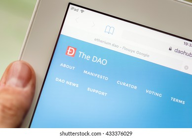 LVIV, UKRAINE - Jun 06, 2016: tablet pc with DAO etherium main page site on screen, etherium is a second coin in crypto-currency market capitalizations in world