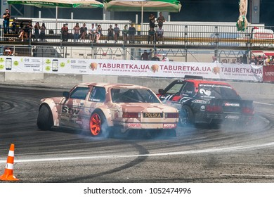 Lviv, Ukraine - June 10, 2017: Unknown riders on the cars brand BMW  overcomes the track in the championship of Ukraine drifting in Lviv, Ukraine.