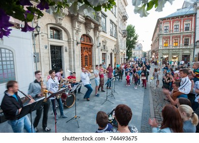 LVIV, UKRAINE - JUNE 10: A full brass band performs to a cheering crowd in Rynok (Market) Square, Lviv on June 10, 2017.