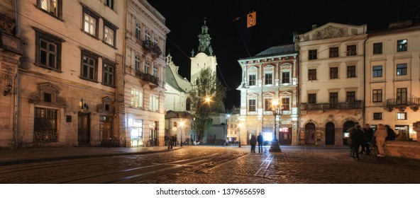 Lviv, Ukraine - June 14 2018: Lviv panorama at night. View of the night street of the European medieval city. Lviv Market square at night.  Concept - travel, landmarks, monument of architecture, world