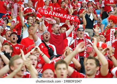 LVIV, UKRAINE - JUNE 17, 2012: Danish football supporters (ultras) show their support during the UEFA EURO 2012 game Germany v Denmark at Lviv Arena in Lviv