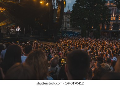 LVIV, UKRAINE - June 18, 2019: wide angel crowd before rock stage at city square. copy space