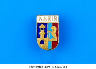 Lviv / Ukraine - june 18, 2019: Soviet metal badge with the image of the Lviv city hall, the lion as the emblem of Lviv and the inscription Lviv