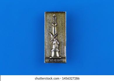 Lviv / Ukraine - june 18, 2019: Soviet metal badge depicting the monument to Adam Mickiewicz in Lviv and inscription Lviv