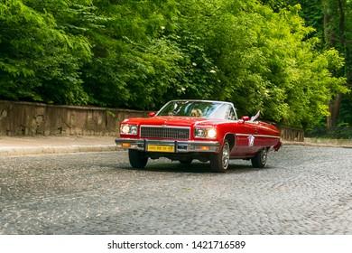 Lviv, Ukraine - June 2, 2019: Old retro car Cadillac Eldorado with its owner and  unknown passenger taking participation in race Leopolis grand prix 2019, Ukraine.