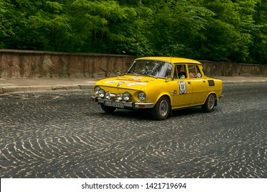 Lviv, Ukraine - June 2, 2019: Old retro car Skoda 110 R with its owner and  unknown passenger taking participation in race Leopolis grand prix 2019, Ukraine.