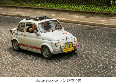 Lviv, Ukraine - June 2, 2019: Old retro car Fiat 695 Abarth (1969)  with its owner and  unknown passenger taking participation in race Leopolis grand prix 2019, Ukraine.