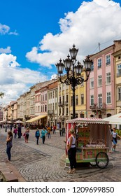 LVIV, UKRAINE - JUNE 29, 2013:  Market square - historical and tourist centre of the town  in Lvov, Ukraine. Historical centre of Lvov is UNESCO World Heritage Site.