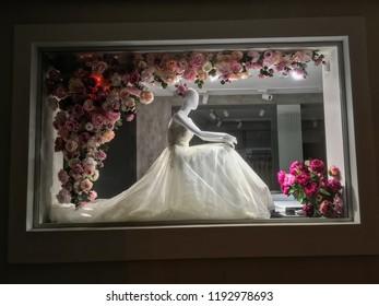 LVIV, UKRAINE - JUNE 29:  Mannequin in a wedding dress, at night in a shop window dressed in roses in Lviv on June 29, 2018 in Lvov, Ukraine