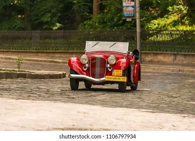 Lviv, Ukraine - June 3, 2018:Old retro car Aero 50 with its owner and an unknown passenger taking participation in race Leopolis grand prix 2018, Ukraine.