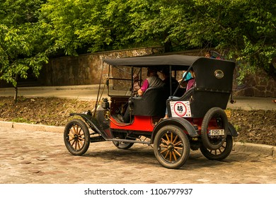 Lviv, Ukraine - June 3, 2018:Old retro car Ford T its owner and an unknown passenger taking participation in race Leopolis grand prix 2018, Ukraine.