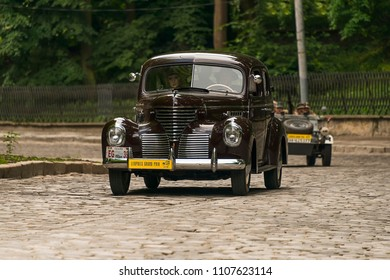 Lviv, Ukraine - June 3, 2018:Old retro car De Soto S6 with its owner and an unknown passenger taking participation in race Leopolis grand prix 2018, Ukraine.