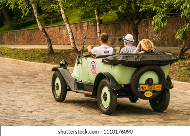 Lviv, Ukraine - June 3, 2018:Old retro car Renault KJ  its owner and an unknown passenger taking participation in race Leopolis grand prix 2018, Ukraine.