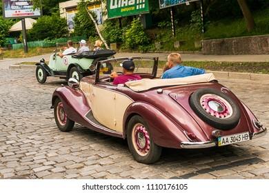 Lviv, Ukraine - June 3, 2018:Old retro car Fiat 508 C & Renault KJ with its owners and an unknown passengers taking participation in race Leopolis grand prix 2018, Ukraine.