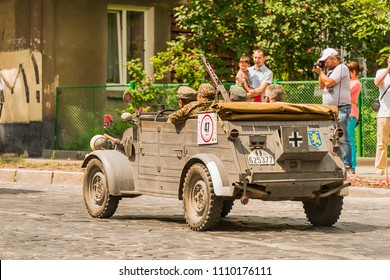 Lviv, Ukraine - June 3, 2018:Old retro car Volkswagen Typ 82 with its owner and an unknown passenger taking participation in race Leopolis grand prix 2018, Ukraine.