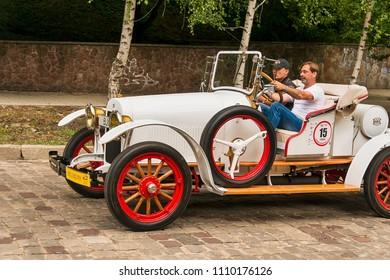 Lviv, Ukraine - June 3, 2018:Old retro car Buick  its owner and an unknown passenger taking participation in race Leopolis grand prix 2018, Ukraine.