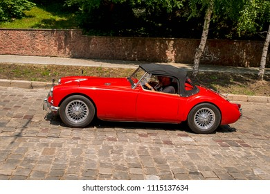 Lviv, Ukraine - June 3, 2018:Old retro car MGA 1500 with its owner and an unknown passenger taking participation in race Leopolis grand prix 2018, Ukraine.