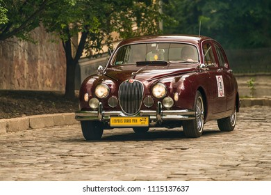 Lviv, Ukraine - June 3, 2018:Old retro car Jaguar MK 3  its owner and an unknown passenger taking participation in race Leopolis grand prix 2018, Ukraine.
