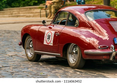Lviv, Ukraine - June 3, 2018:Old retro car Porsche 356 B with its owner and an unknown passenger taking participation in race Leopolis grand prix 2018, Ukraine.