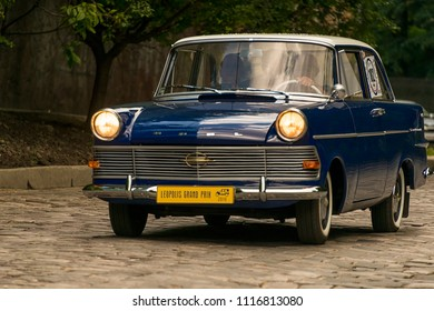 Lviv, Ukraine - June 3, 2018:Old retro car Opel RFN with its owner and an unknown passenger taking participation in race Leopolis grand prix 2018, Ukraine.