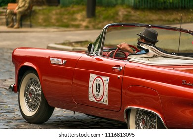 Lviv, Ukraine - June 3, 2018:Old retro car Ford Thunderbird with its owner and an unknown passenger taking participation in race Leopolis grand prix 2018, Ukraine.