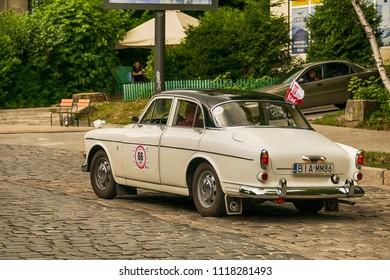 Lviv, Ukraine - June 3, 2018:Old retro car Volvo Amazon P121  its owner and an unknown passenger taking participation in race Leopolis grand prix 2018, Ukraine.