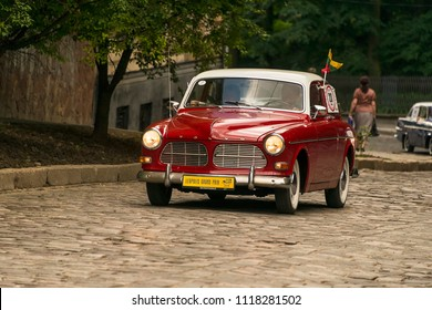 Lviv, Ukraine - June 3, 2018:Old retro car Volvo Amazon 13134  its owner and an unknown passenger taking participation in race Leopolis grand prix 2018, Ukraine.
