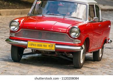 Lviv, Ukraine - June 3, 2018:Old retro car Lloyd Arabella with its owner and an unknown passenger taking participation in race Leopolis grand prix 2018, Ukraine.