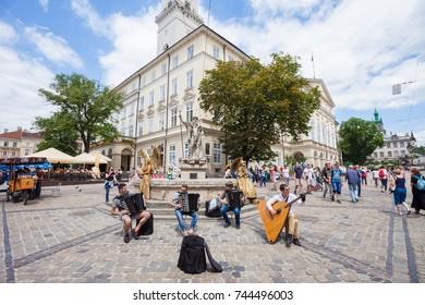 LVIV, UKRAINE - JUNE 3: Street musicians perform Bach on accordions and a balalaika contrabass in Rynok Square, Lviv, Ukraine on 3 June 2017.