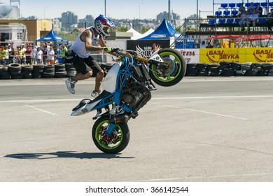 Lviv, Ukraine - June 7, 2015: Unknown stunt bikers entertain the audience before the start of the championship of drifting near Arena - Lviv stadium in Lviv, Ukraine.