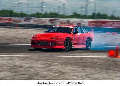 Lviv, Ukraine - Juny 01, 2019: Unknown rider on the car brand Nissan overcomes the track in the championship of Ukraine drifting in Lviv.