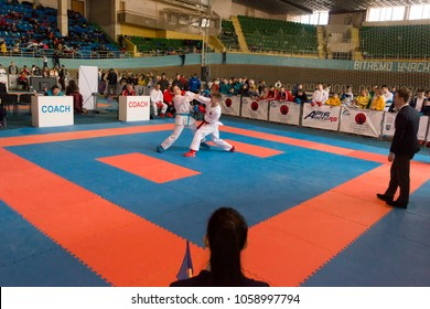 Lviv , Ukraine - March 25, 2018: International open karate cup . Unknown judges watch the duel of athletes during the competition  in the sports complex of the army,  Lviv, Ukraine.