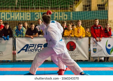 Lviv , Ukraine - March 25, 2018: International open karate cup . Unknown participants of the tournament hold a duel in the sports complex of the army,  Lviv, Ukraine.