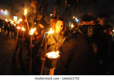 Lviv, Ukraine, March 7, 2020. Members of the nationalist organizations hold torches as they take part in a rally marking the 70th death anniversary of Roman Shukhevych, leader of the UPA.
