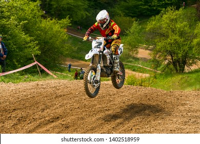 Lviv , Ukraine - May 12 2019:  Open Cup of Lviv on the motocross track Mayorovka.  Unknown  motorcycle racer overcome the track in the fight for the championship.