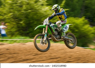 Lviv , Ukraine - May 12 2019:  Open Cup of Lviv on the motocross track Mayorovka.  Motorcycle racer Roman Kruk overcome the track in the fight for the championship.