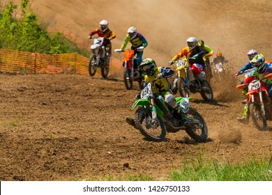 Lviv , Ukraine - May 12 2019:  Open Cup of Lviv on the motocross track Mayorovka.  Unknown  motorcycle racers overcome the track in the fight for the championship.