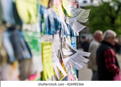 Lviv, Ukraine - May 17, 2016: Bulletin board with colourful tear-off messages waving in wind.