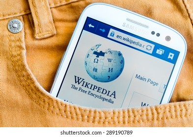 LVIV, UKRAINE - May 19, 2015: white Samsung Smart Phone with Wikipedia main page screen in the pocket of orange jeans
