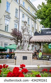 LVIV, UKRAINE - MAY 26, 2016: Statue of Diana, Roman Goddess of the hunt, with a dog