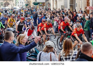 Lviv, Ukraine - May 6, 2017: cycling marathon VIII Lviv 100km ride, 425 bicycles, in the streets of the city. participants and athletes riding bikes. man in red form bicycling