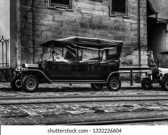 LVIV, UKRAINE - NOVEMBER 20, 2018: Old retro car Ford T its owner and an unknown passenger. Ukraine