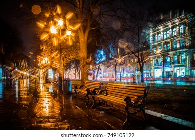 Lviv, Ukraine  -  November 3, 2017: Lviv benches at rainy night