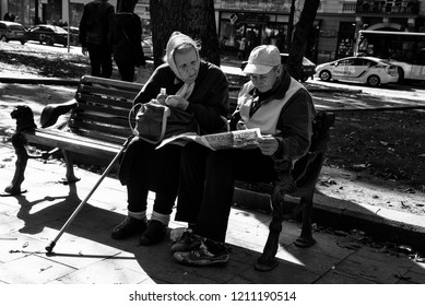 LVIV / UKRAINE - OCTOBER 06, 2018: Two old women rest on a bench, Svobody av. in Lviv city