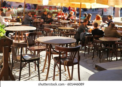 LVIV, UKRAINE - OCTOBER 06: Little tables of cafeteria on the street at sun day on October 06, 2013 in Lviv