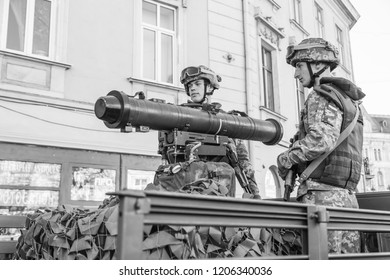 Lviv, Ukraine - October 14, 2018: March of defenders of Ukraine. Day of the defenders of Ukraine. Soldiers on military vehicle