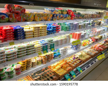 """LVIV, UKRAINE - OCTOBER 16: Cream cheese and curd in assortment lying in a showcase in a supermarket """"Silpo"""" on October 16, 2019 in Lviv, Ukraine"""